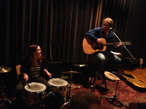 Emily plays a Bo Diddly beat with Jan Holtman.
